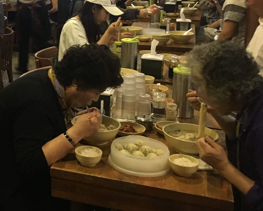 People eating noodles at Myeongdong Kyoja