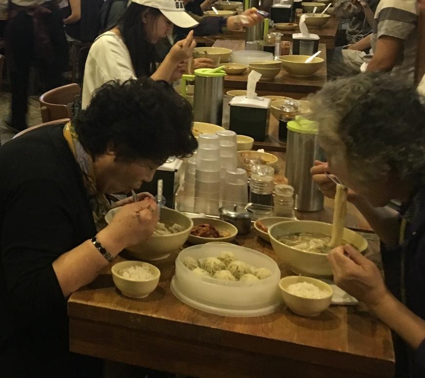 People eating noodles at Myeongdong Kyoja